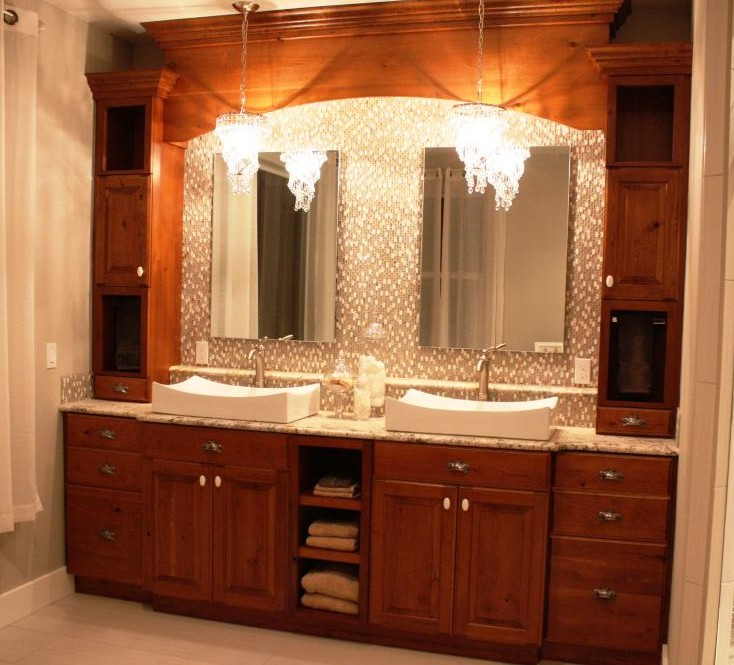 Cherry wood bathroom cabinets with mirror surrounds. Custom designed, built and installed for customer in Kennewick, WA by Legacy Mill & Cabinet. Visit our showrooms in Richland, WA and North Salt Lake, UT.