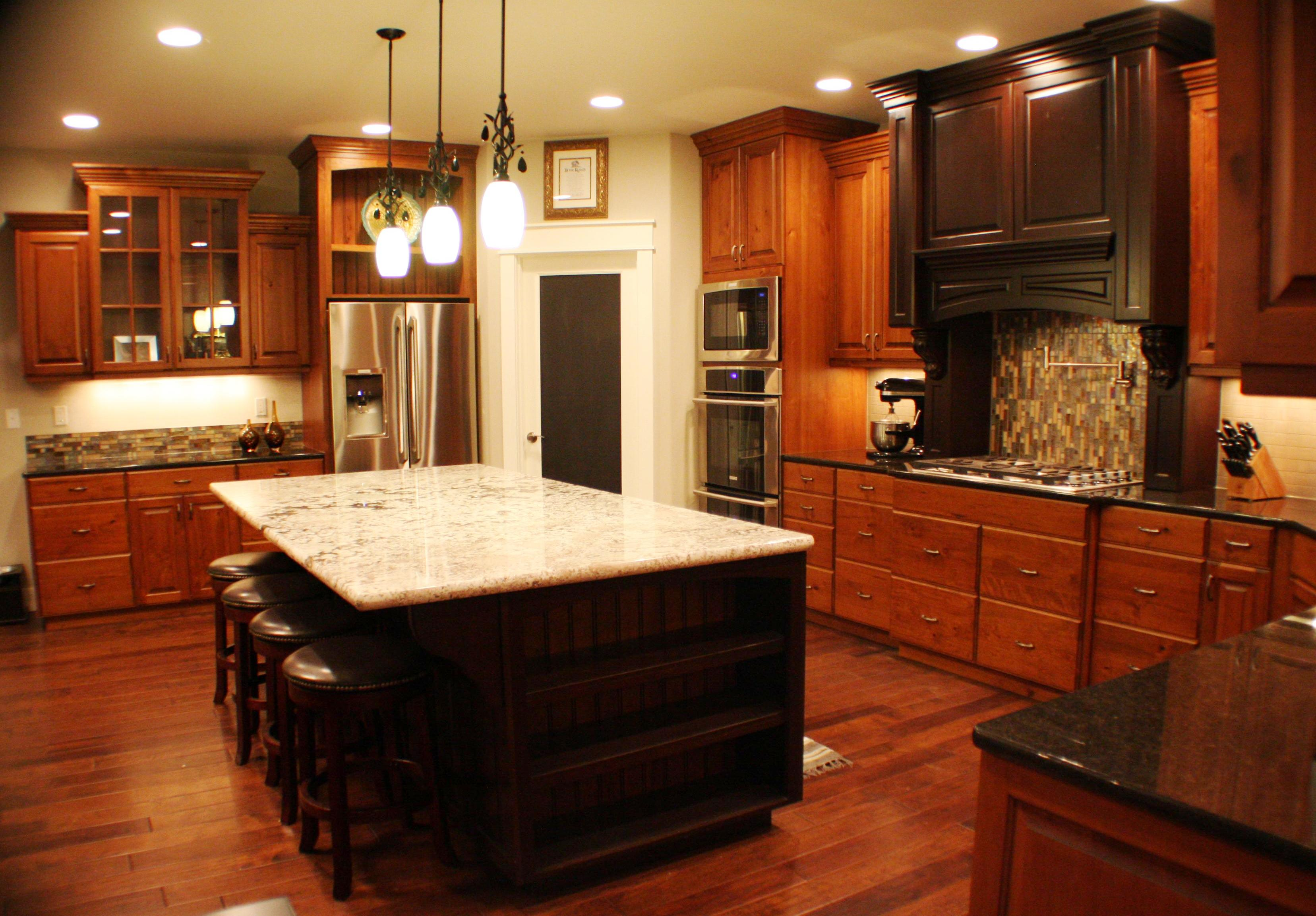 Custom cherry kitchen cabinets finished with Easy Oak colored stain topped with a brown glaze.