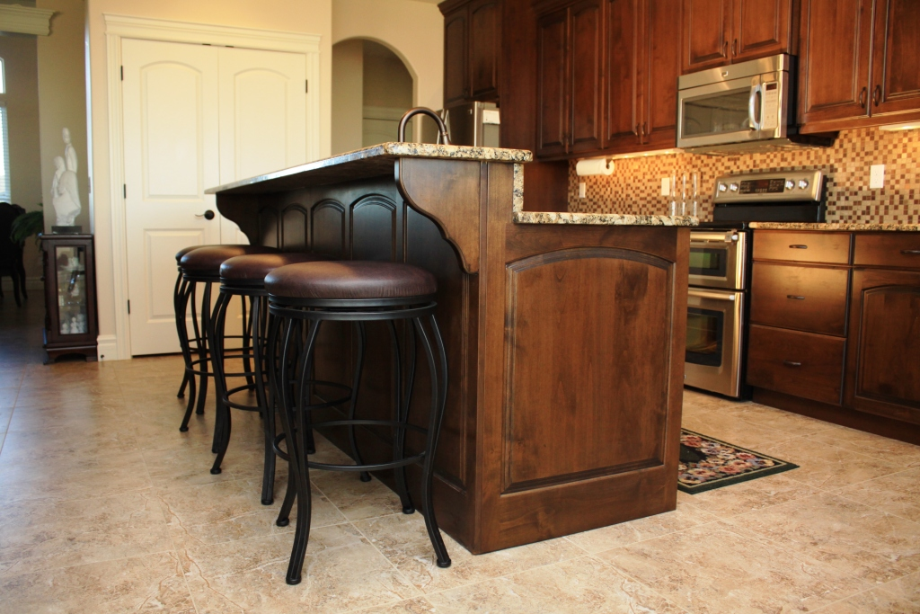 Kitchen island cabinets made from alder wood with a dark walnut stain finish. Custom designed, built and installed for a private residence in Kennewick, WA